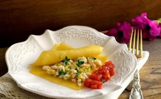 Raviolo aperto di pasta fresca con persce di lago