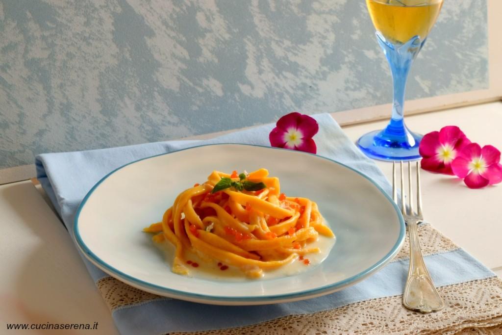 pasta di zucca con salsa di grana padano e caviale di pomodoro