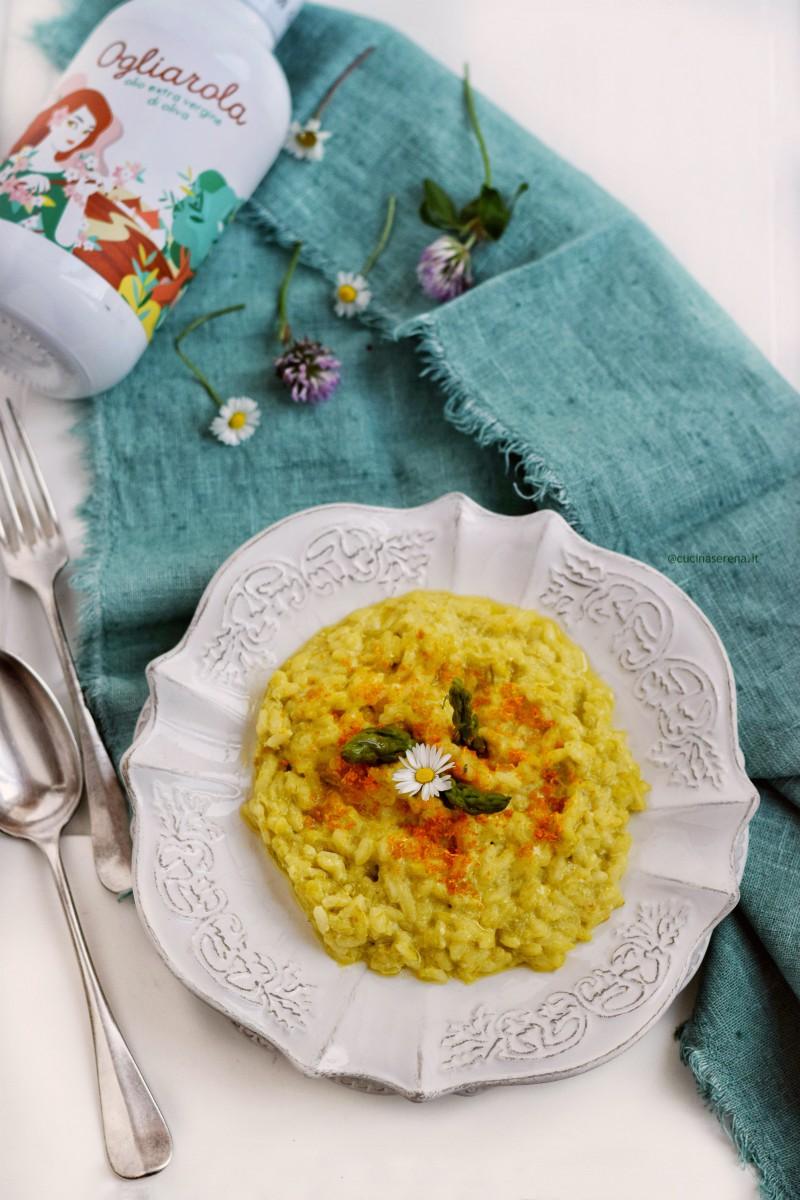 Risotto con crema di asparagi, panna e succo e scorza di arancia