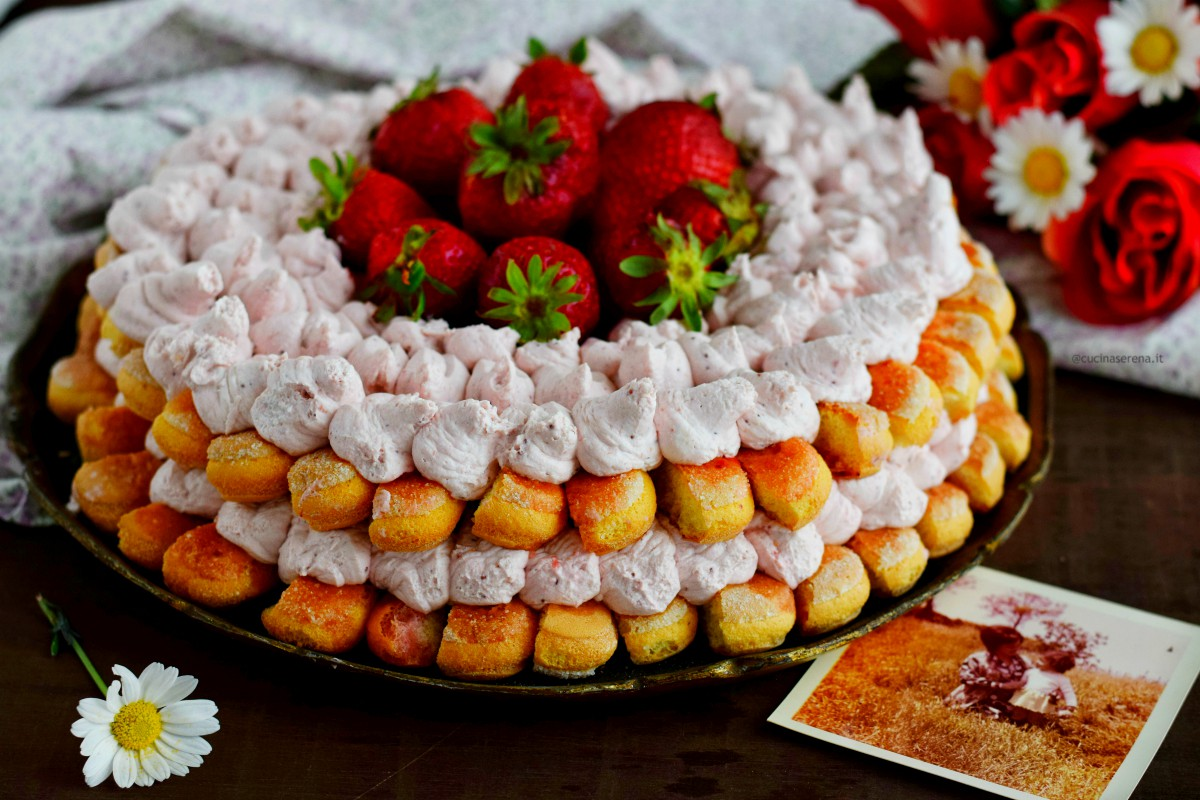 Strawberries tiramisù cake made with savoiardi biscuit dipped  in strawberries sauce and stuffed with mascarpone and whipped cream
